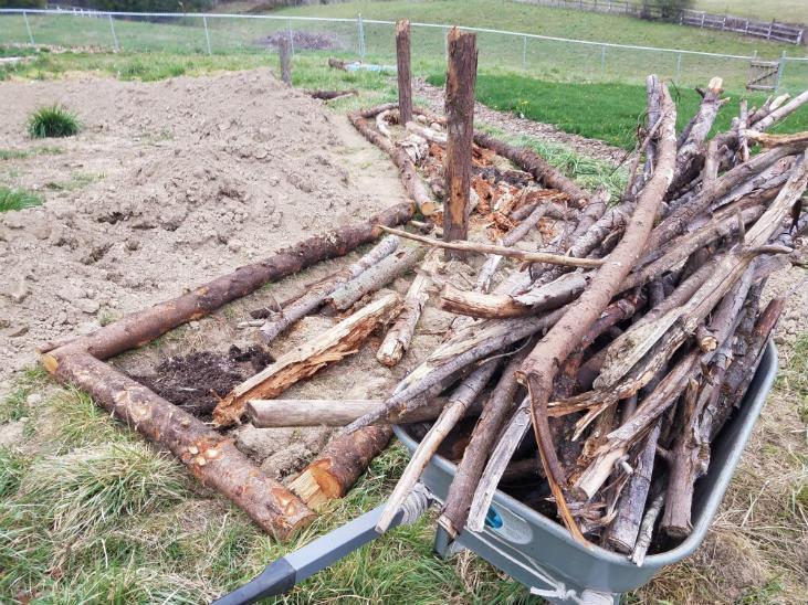 Build a hugelkultur bed with medium pieces of wood